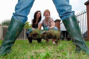 girls installing grass